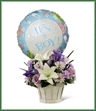 The Boys Are Best! Bouquet is blooming with sweet love to congratulate the new family on their darling baby boy! Lavender roses, blue iris, lavender carnations, lavender daisies, white Asiatic lilies and lush greens are beautifully arranged in a round whitewash woodchip basket. Presented with a Mylar balloon declaring,