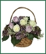 Celebrate a life well lived and honor their passing with this serene basket arrangement of purple hydrangea, lavender and white roses and baby's breath.
