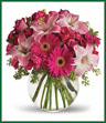 Youthful. Graceful. Beautiful. These are just a few qualities that come to mind when gazing at a gorgeous bouquet of pink flowers. Whether you want this arrangement to say