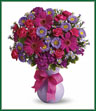 Sending a jubilation of flowers is a joyful way to brighten any celebration. This particular arrangement is eye-catching, colorful and captivating. Hot pink spray roses and gerberas, dark pink Sweet William, lavender matsumoto and purple monte cassino asters are joined by greens in an exclusive lavender keepsake vase. Tied with a ribbon, it's ready to shine. Vase may vary.