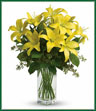 When it comes to spring flowers, the lily reigns supreme. It's easy to see why in this gorgeous bouquet of bright yellow blooms. A fabulous bouquet of yellow asiatic lilies, salal and seeded eucalyptus are delivered in a divine bunch vase.