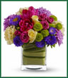 Oh, what a fine day it will be when you have this delightful spring bouquet delivered to someone special. Everyone will delight in the vibrant colors and bountiful blossoms, all thoughtfully arranged in a beautiful leaf-lined vase. Light yellow roses, hot pink spray roses, tulips and gerberas, yellow carnations, green button spray chrysanthemums and lavender cushion spray chrysanthemums are delivered in an exclusive cube vase. You'll have many fine days when you send this beautiful bouquet!