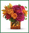 Hot times require haute arrangements. Look no further because this vibrant vase full of vivacious flowers has va-voom written all over it. Light orange roses, orange asiatic lilies, hot pink dahlias and carnations are delivered in a dazzling cube vase. Chic? For sure! Color of vase may vary.