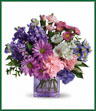 If you're looking for a delightful gift that's full of heart, look no further than this beautiful bouquet. A pretty mix of beautiful flowers arranged in a cube vase will express your wishes perfectly. This stunning bouquet includes white alstroemeria, pink carnations and miniature carnations, purple lisianthus, daisy spray chrysanthemums and monte cassino asters, pink matsumoto asters, lavender stock, pink statice and greens delivered in a modern lavender cube vase. It's a heartfelt gift that's sure to delight. Vase may vary.