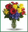Whether you are raising a vase to celebrate a birthday, a new job or any other occasion, here's the one to send. So bright, so beautiful, so colorful – men and women alike will appreciate your thoughtfulness. Brilliant blue hydrangea, yellow roses, red gerberas and miniature carnations, yellow button spray chrysanthemums are delivered in a vase. Here's to celebrating! Style of vase may vary.