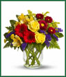 You'll want to put this colorful bouquet on your hit parade of gifts to send. Bold primary colors and a perfect mix of flowers make it great for men and women of all ages. In other words, it's a perfect arrangement. Yellow roses, alstroemeria, and button spray chrysanthemums, red miniature gerberas and matsumoto asters along with purple statice, salal and fern are delivered in a lovely hurricane vase. It's a garden parade to be proud of!