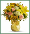 What better gift to send someone than a sunny smile? Think how much that sentiment delivered in the form of this beautiful and cheerful bouquet will mean to whoever's on your mind today. Dazzling green roses, peach spray roses, yellow asiatic lilies, alstroemeria and solidago along with beautiful leafy greens are delivered in a yellow Serendipity vase. Send a sunny smile today!  Vase may vary.