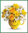 There are probably a million reasons this is such a popular bouquet. Of course, there are probably just as many reasons to send this cheerful arrangement. Full of happy flowers, this ceramic happy face mug will bring smiles for years to come. Especially when filled with that first cup of morning coffee or cocoa! Yellow roses and daisy spray chrysanthemums along with white daisy spray chrysanthemums and oregonia are delivered in the one and only Be Happy® mug.