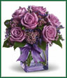 Shades of purple are in perfect harmony in this profoundly pretty arrangement. A lovely mix of classic and modern, ribbons and roses, it's sure to make someone's day! Lavender roses and waxflower, purple limonium and greens are hand-delivered in a lavender cube that's all wrapped up with a vibrant purple taffeta ribbon.  Vase may vary.