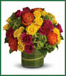 Blow someone away with a bouquet that has so much style… all it needs is its own runway. Brilliant green hydrangea, hot pink and bi-color roses, hot pink and yellow spray roses and greens are hand-delivered in stunning style: a wide cylinder vase that's been elegantly lined with leaves. This bouquet is a singular sensation!